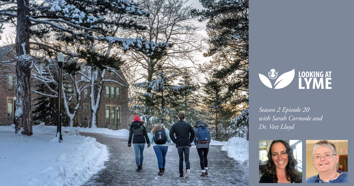 Students walk on campus at Mount Allison, beside the Looking at Lyme logo.